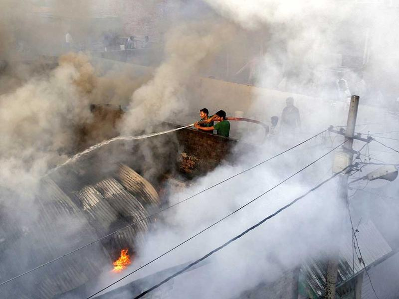 Firefighters try to douse a fire at a cotton factory in Allahabad. (Reuters photo)