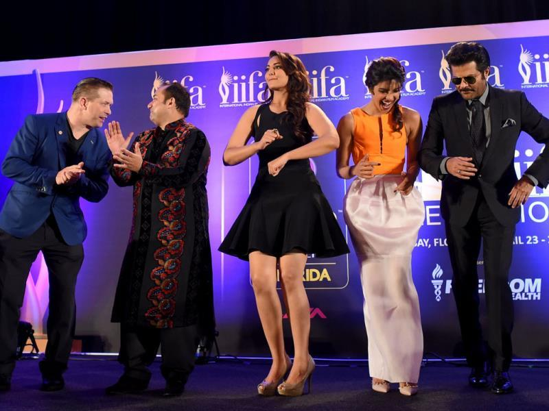 US actor Stephen Baldwin, Rahat Fateh Ali Khan, Sonakshi Sinha, Priyanka Chopra and Anil Kapoor dance to the tune of the IIFA anthem Do Da Tampa on stage during a press conference on the second day of the IIFA awards. (AFP)