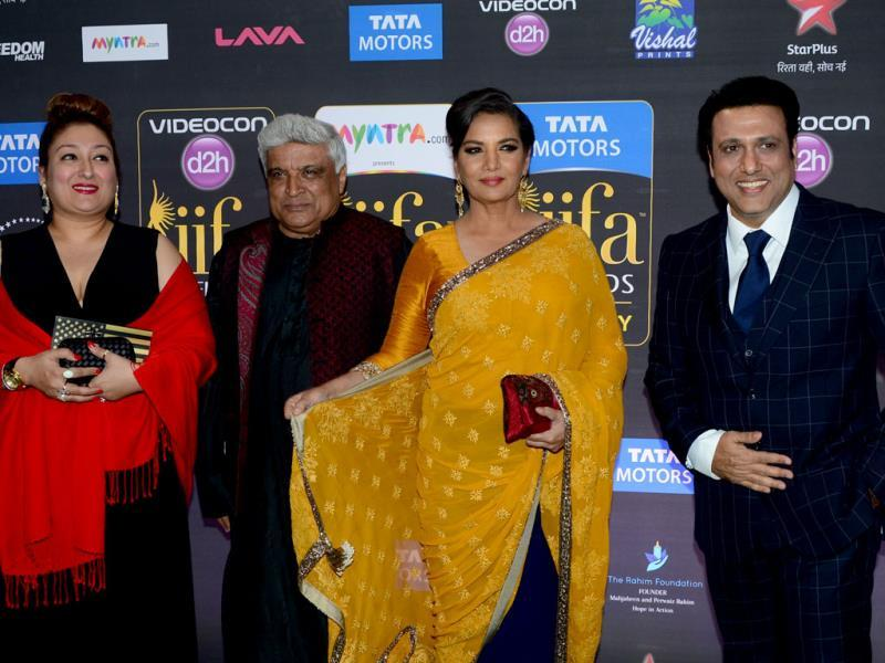 Javed Akhtar and Shabana Azmi pose with Govinda and his wife, Sunita on the green carpet at the Tampa Convention Center ahead of IIFA Rocks on the second day of IIFA awards. (AFP)