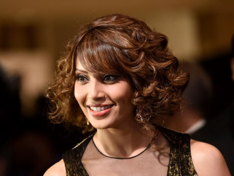 Bipasha Basu flaunts her new hairstyle at the Tampa Convention Center ahead of IIFA Rocks on the second day of the 15th International Indian Film Academy. (AFP)