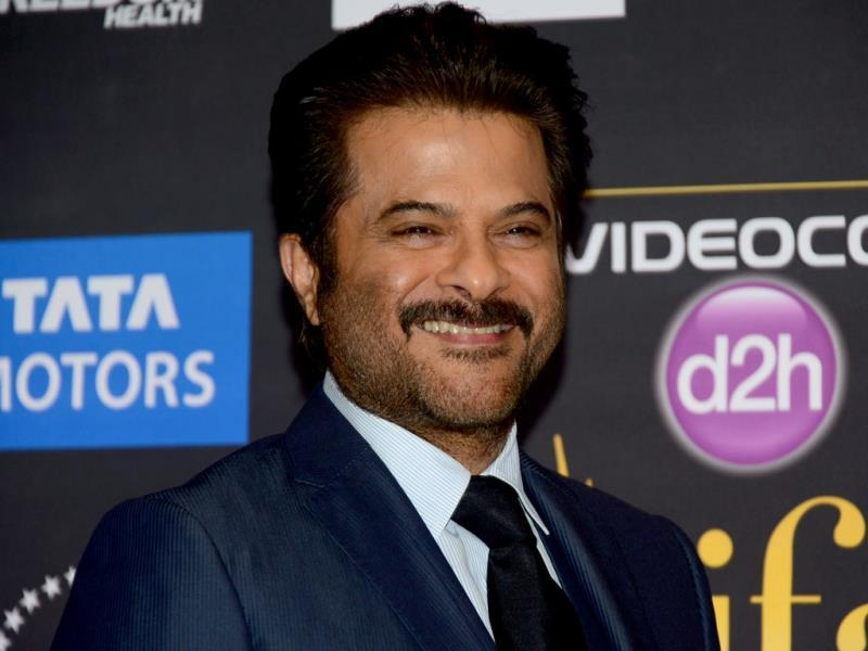 Anil Kapoor poses for the shutterbugs on the green carpet during the press conference. (AFP)