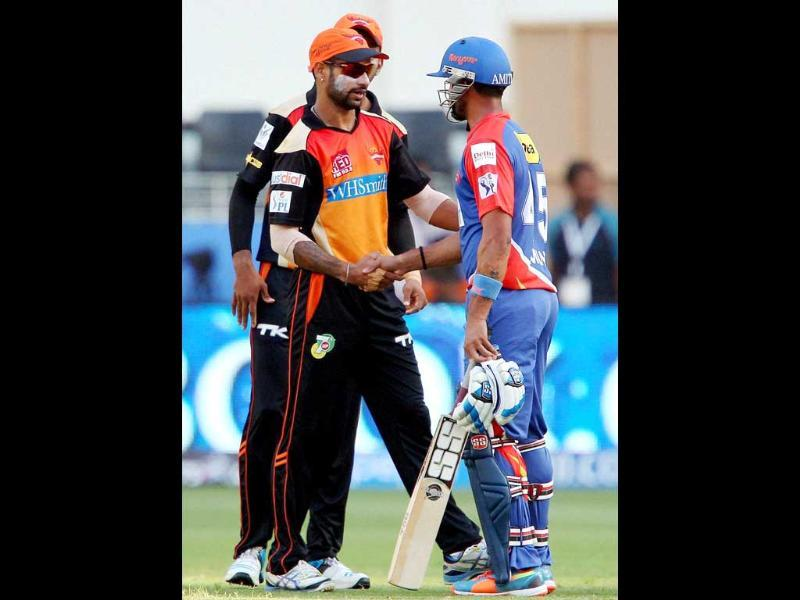 Sunrisers Hyderabad captain Shikhar Dhawan shakes hands with Delhi Daredevils batsman after winning the IPL 7 match in Dubai (PTI Photo)