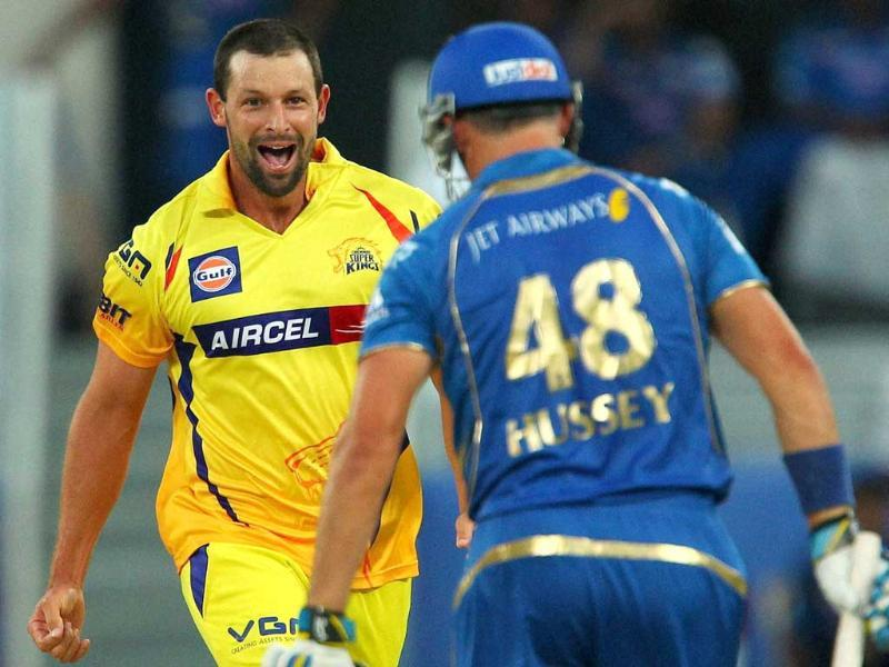 Chennai Super Kings' Ben Hilfenhaus celebrates the wicket of Mumbai Indians' Michael Hussey during an IPL 7 match in Dubai. (PTI photo)
