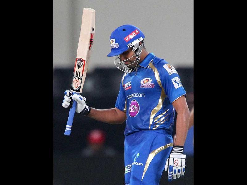 Mumbai Indians' captain Rohit Sharma celebrates his fifty during an IPL 7 match against Chennai Superkings in Dubai. (PTI photo)