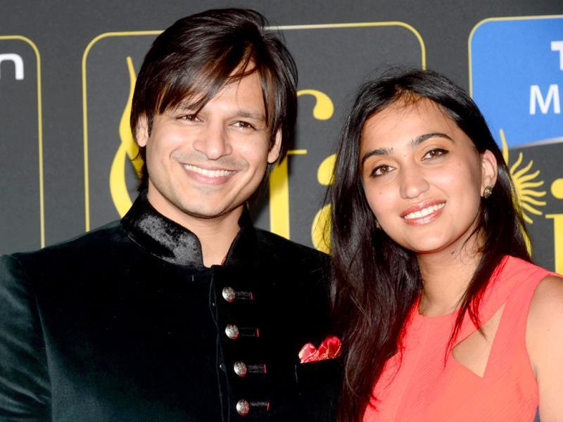 Vivek Oberoi poses with his wife Priyanka at the Mid Florida Credit Union Amphitheater during the IIFA Magic of the Movies show on the third day of the 15th International Indian Film Academy (IIFA) Awards in Tampa, Florida. (AFP)