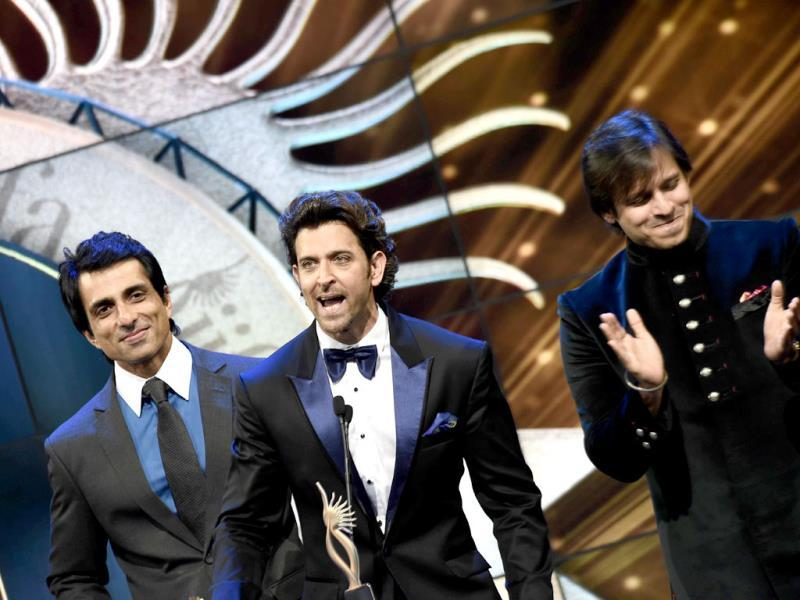Sonu Sood, Hrithik Roshan and Vivek Oberoi appear on stage at the Mid Florida Credit Union Amphitheater during the IIFA Magic of the Movies. (AFP)