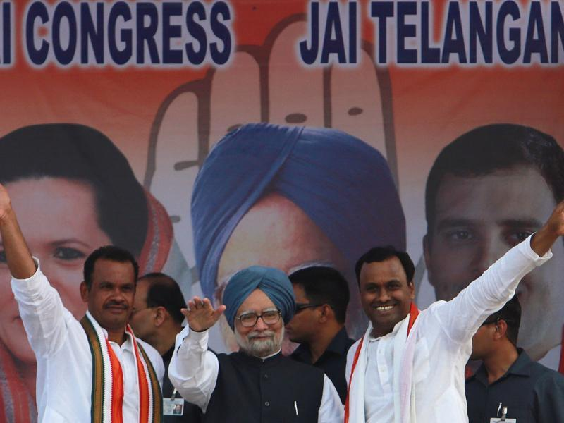 PM Manmohan Singh and other party leaders greet supporters during an election rally in Bhongir, Andhra Pradesh. (AP Photo)