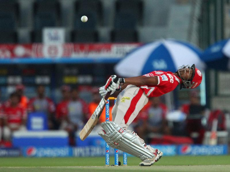 Kings XI Punjab's Wriddhiman Saha avoids a delivery from Kolkata Knight Riders' Morne Morkel during the IPL7 match in Abu Dhabi. (PTI Photo)