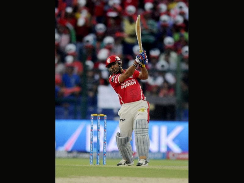 Kings XI Punjab's Virender Sehwag plays a shot against Kolkata Knight Riders during their IPL7 match in Abu Dhabi. (PTI Photo)