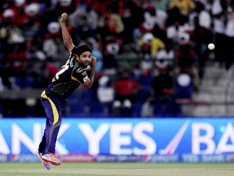 Piyush Chawla of Kolkata Knight Riders bowls during their IPL7 match against Kings X1 Punjab in Abu Dhabi. (PTI Photo)