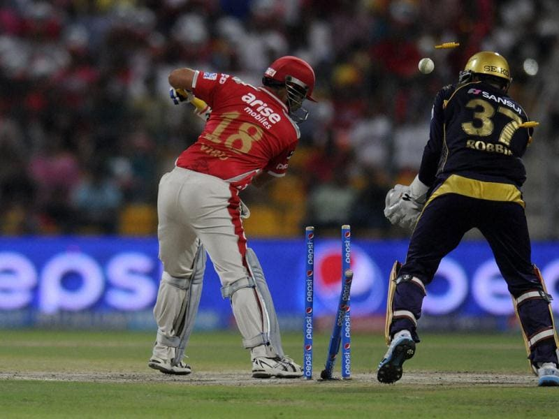 Virender Sehwag of Kings X1 Punjab gets bowled out by Piyush Chawla of Kolkata Knight Riders during their IPL match in Abu Dhabi. (PTI Photo)