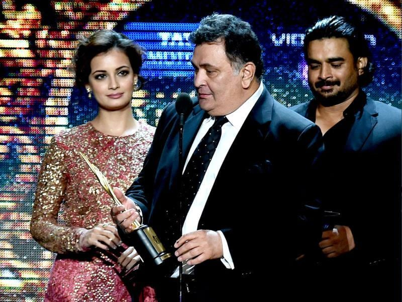 Bollywood actor Rishi Kapoor receives the award for Best performance in a Negative Role during the fourth and final day of the 15th International Indian Film Academy (IIFA) Awards at the Raymond James Stadium in Tampa, Florida. (AFP)