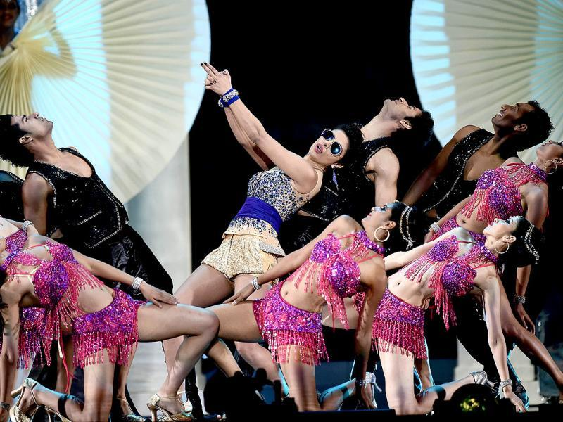 Bollywood actress Priyanka Chopra performs on stage during the fourth and final day of the 15th International Indian Film Academy (IIFA) Awards at the Raymond James Stadium in Tampa, Florida,. (AFP)
