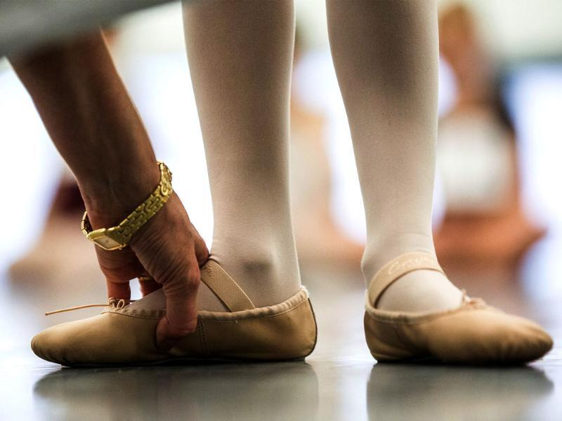 A girl has her posture tested while auditioning for the School of American Ballet (AFP Photo)