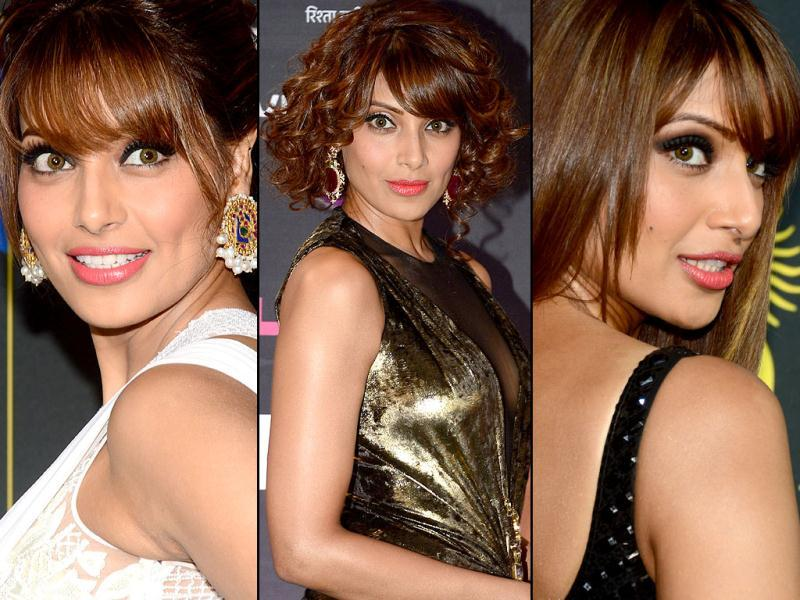 Bipasha Basu looked stunnimg at all IFFA events. She poses on the green carpet at the Mid Florida Credit Union Amphitheater and at the green carpet at the Tampa Convention Center ahead of IIFA Rocks. (AFP)