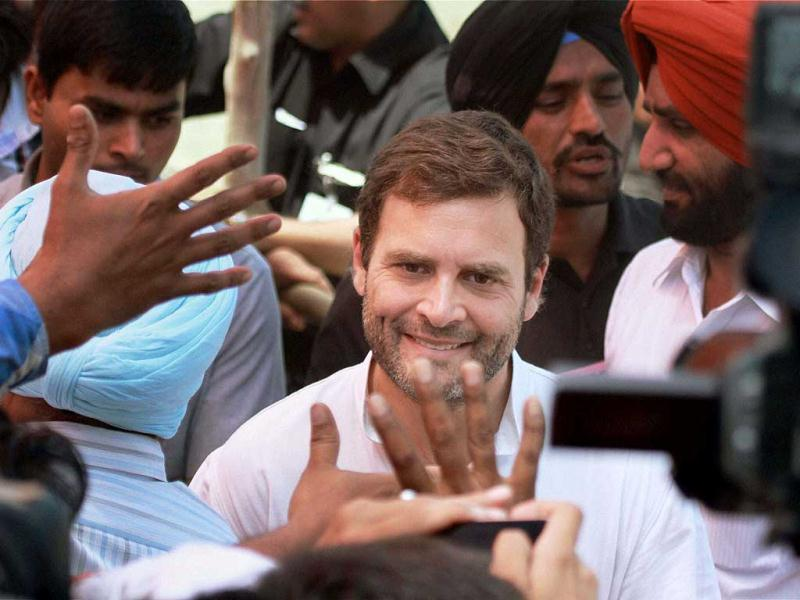 Congress vice-president Rahul Gandhi interacts with party supporters at an election rally in Bathinda. (PTI Photo)