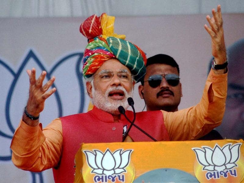 BJP's PM candidate Narendra Modi addresses an election campaign rally in Anand. (PTI photo)