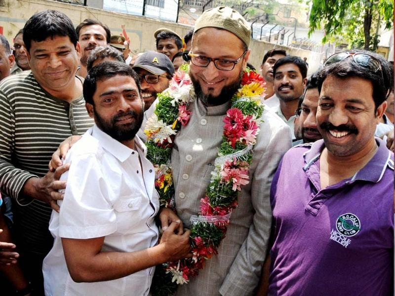 MIM chief Asaduddin Owaisi with his supporters in Hyderabad. (PTI file photo)