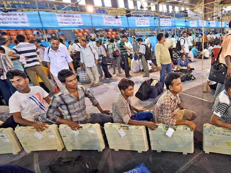 EVMs being delivered to polling officials at a distribution centre in Howrah district of West Bengal. (PTI Photo)