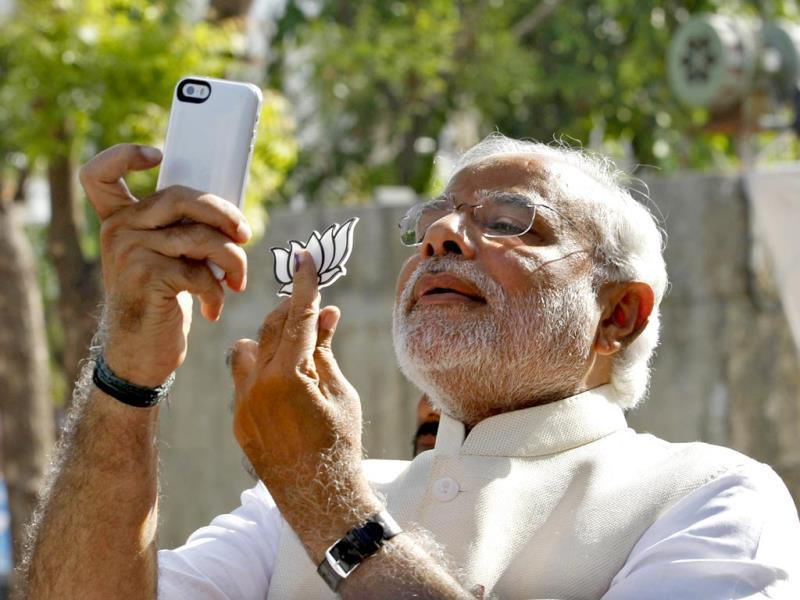 Modi clicks a selfie of his inked finger with the BJP symbol, the lotus. (Reuters File Photo)