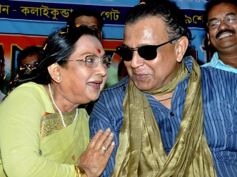 Actor and TMC MP Mithun Chakraborty with veteran actor and TMC candidate Sandhya Roy during her election campaign rally in West Midnapore district of West Bengal. (PTI Photo)