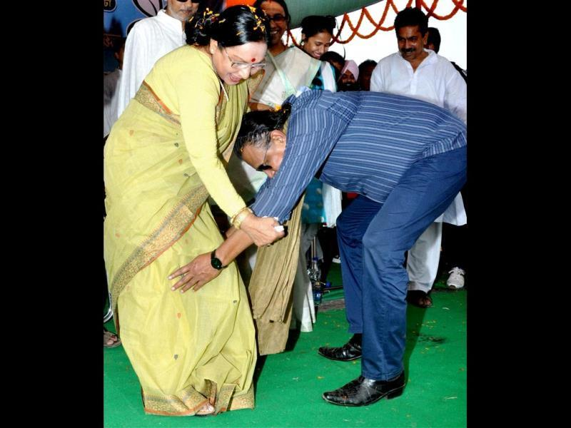 Trinamool Congress MP Mithun Chakraborty seeks blessings of veteran actor and TMC candidate Sandhya Roy during her election campaign in West Midnapore district of West Bengal. (PTI Photo)