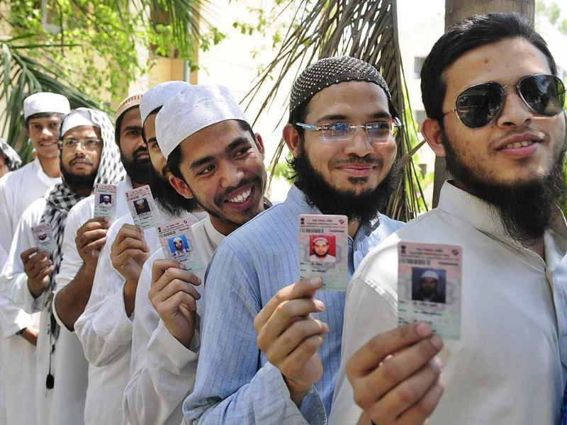 Young Muslim voters show voter ID card after casting their vote at old city in Lucknow, India. (Deepak Gupta/HT Photo)