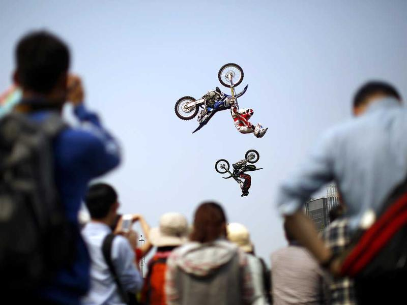 Competitors perform at the FMX Course competition during the World Extreme Games in Shanghai. (Reuters)