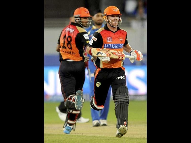 KL Rahul and David Warner of Sunrisers Hyderabad run between the wickets during their IPL 7 match against Mumbai Indians in Dubai. (PTI Photo)