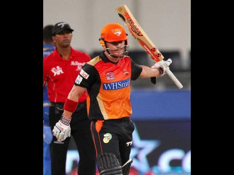 David Warner of Sunrisers Hyderabad celebrates his fifty during their IPL 7 match against Mumbai Indians in Dubai. (PTI Photo)