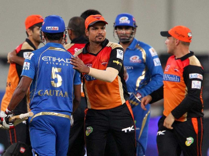 Players shake hands after an IPL 7 match between Mumbai Indians and Sunrisers Hyderabad in Dubai. (PTI Photo)