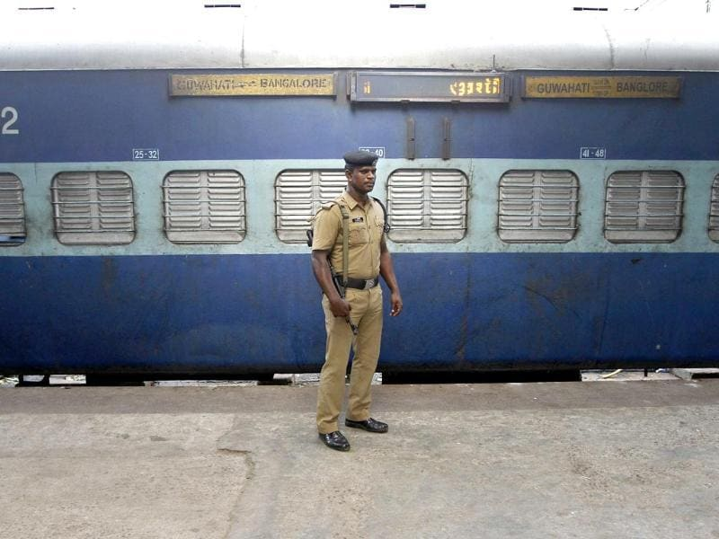A policeman stands guard next to a passenger train in which two explosions occurred, at the railway station in Chennai. (Reuters photo)