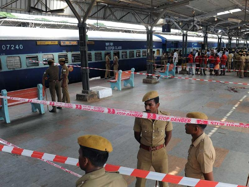 Police and train station workers stand near the site of a bomb attack at a train station in Chennai. (AFP photo)