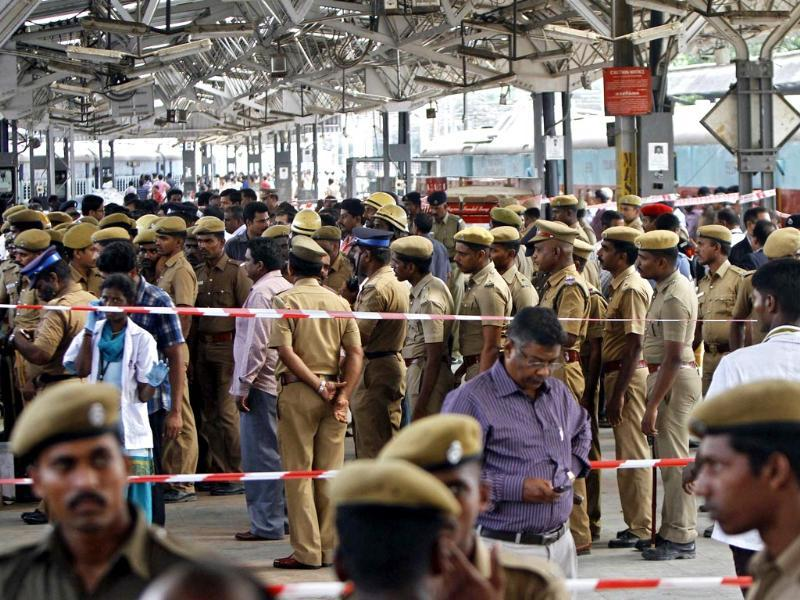 Cops and security officials stand near a passenger train in which two explosions occurred, at Chennai railway station.(Reuters photo)