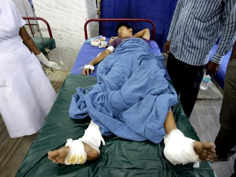 Medics treat an injured passenger of a train blast at a hospital in Chennai.(AP photo)