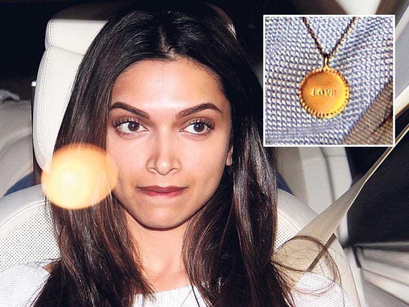 Deepika Padukone was spotted wearing a gold pendant with the word 'love' inscribed on it. We wonder if that's a gift from a special someone!