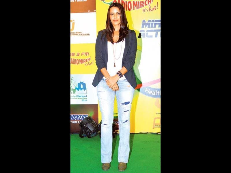 Neha Dhupia: This would've been fine if the jeans were tapered at the bottom. Rips and boot-cuts aren't the best combination.Our rating: 5/10