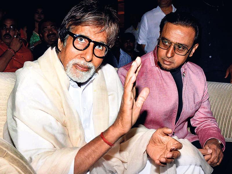 While Amitabh Bachchan waves at the army of photographers clicking his pictures at an event, Gulshan Grover's eyes are just transfixed on the superstar.