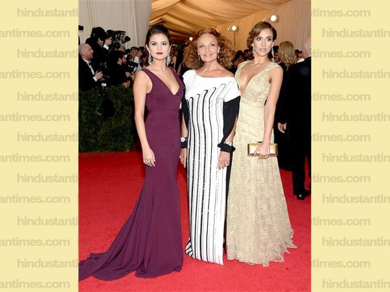 Singer-actress Selena Gomez, from left, designer Diane von Furstenberg and actress Jessica Alba arrive at The Metropolitan Museum of Art's Costume Institute benefit gala celebrating Charles James: Beyond Fashion in New York. (AP)