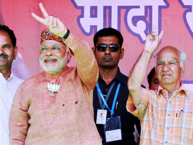 BJP PM candidate Narendra Modi with party candidate from Kangra, Shanta Kumar during an election rally in Palampur. (PTI Photo)