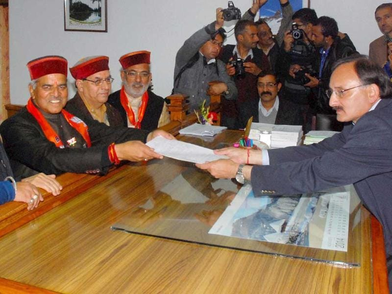 BJP candidate Virender Kashyap with party leaders files his nomination papers in Shimla. (PTI Photo)
