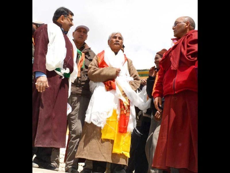 BJP candidate Thupstan Chhewang with Tarun Vijay on their way to file nomination papers in Leh. (PTI Photo)