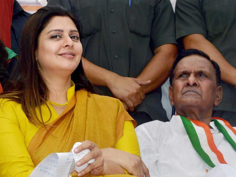 Congress candidates Nagma and Beni Prasad Verma during an election campaign in Pilibhit. (PTI Photo)