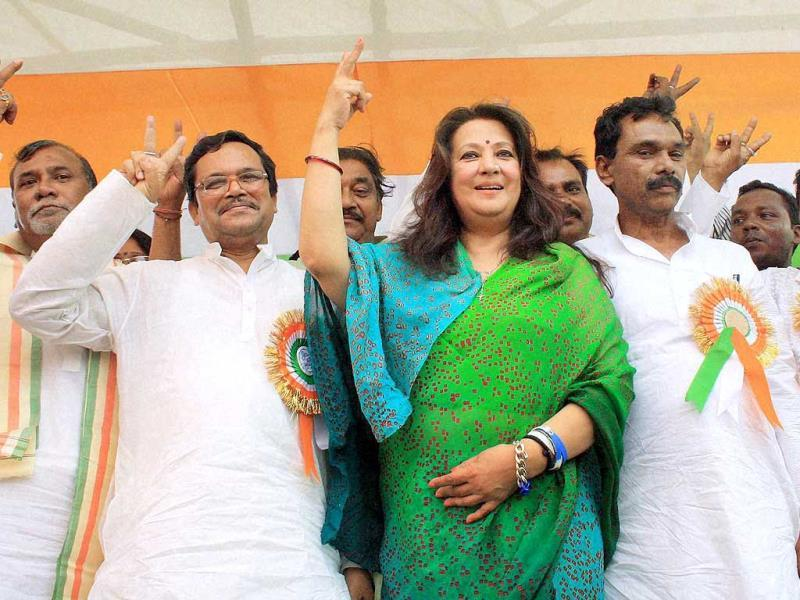 TMC candidate Moon Moon Sen with party leaders during an election meeting in Purulia. (PTI Photo)