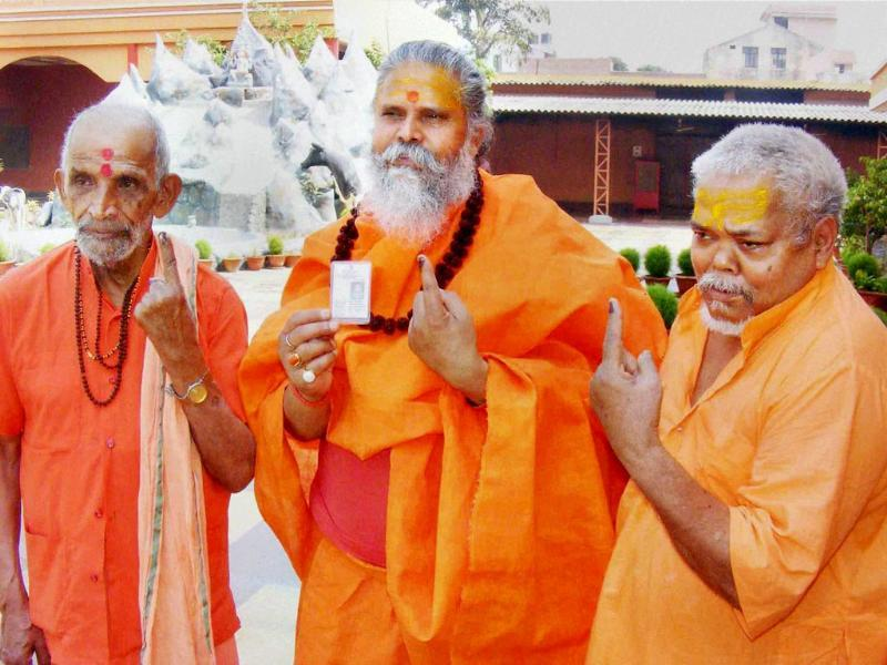 Mahant Narendra Giri Ji Maharaj and other sadhus show their inked fingers in Allahabad. (PTI photo)