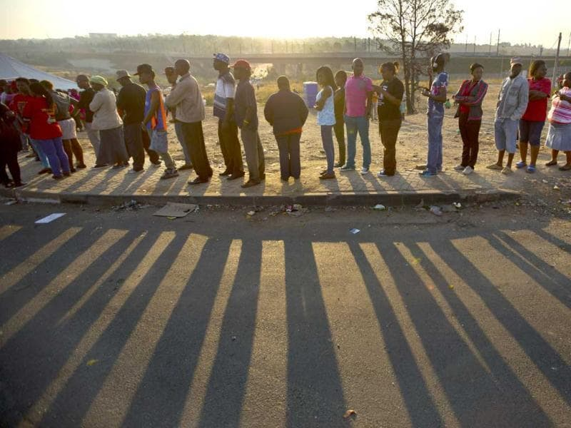 South Africans queue to cast their votes at a polling station in the Alexandra township of Johannesburg, South Africa. (AP Photo)