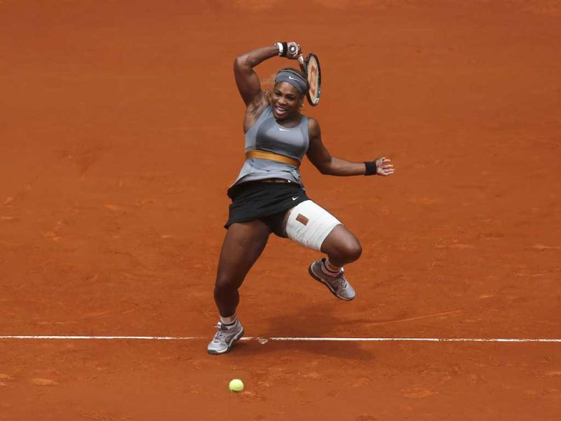 Serena Williams from US returns the ball to Shuai Peng from China during Madrid Open tennis tournament match in Madrid, Spain. (AP Photo)