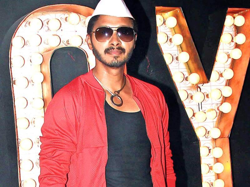 Shreyas Talpade, wearing an odd combination of a western outfit with a Gandhi cap, was at a shoot in Goregaon.