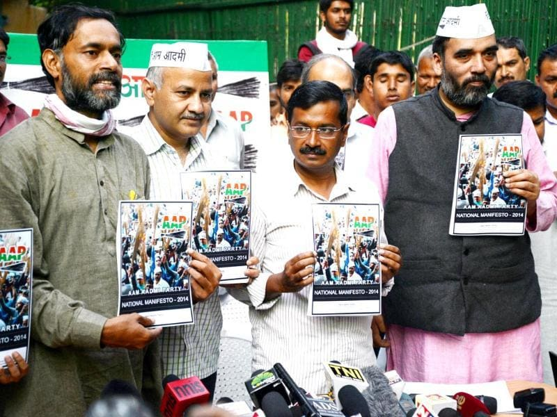 AAP leader Arvind Kejriwal with party leaders Manish Sisodia, Yogendra Yadav and Gopal Rai releases the party's election manifesto ahead of Lok Sabha elections. (PTI photo)