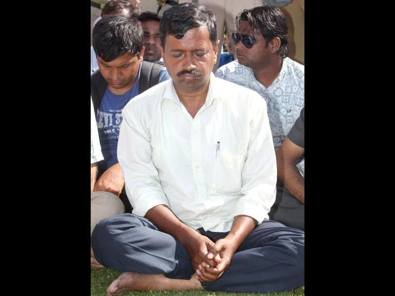Arvind Kejriwal offers prayers at Mahatma Gandhi's samadhi Rajghat. He was slapped by an auto driver during a roadshow in Delhi. (PTI photo)